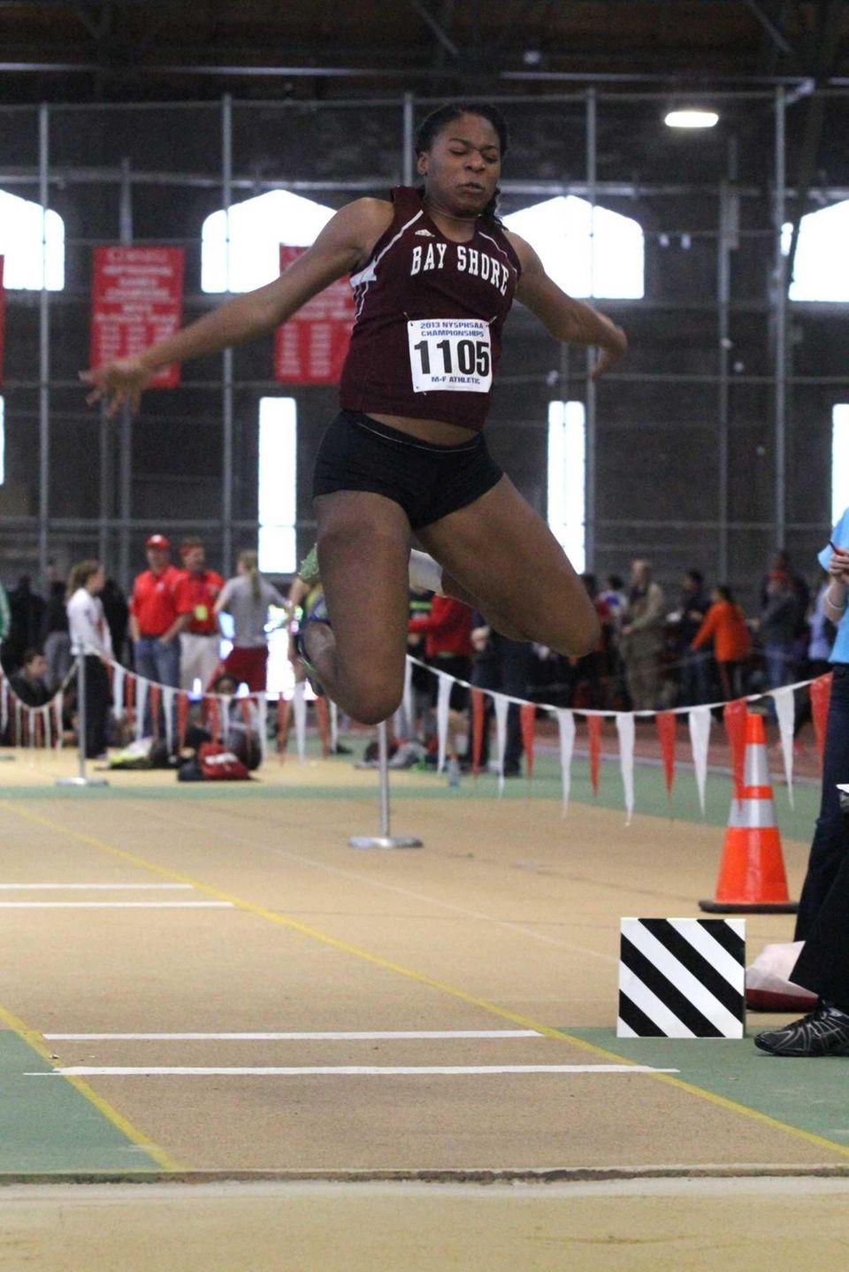 Bay Shore's Anisa Toppin flies through the air