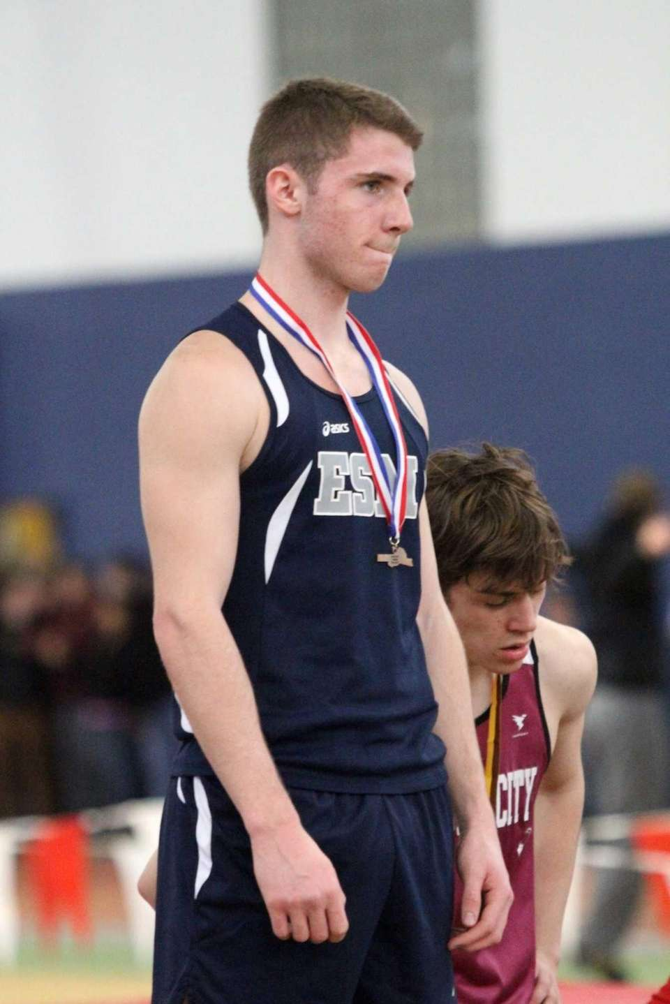 Eastport-South Manor's Tom Meehan receives his medal after