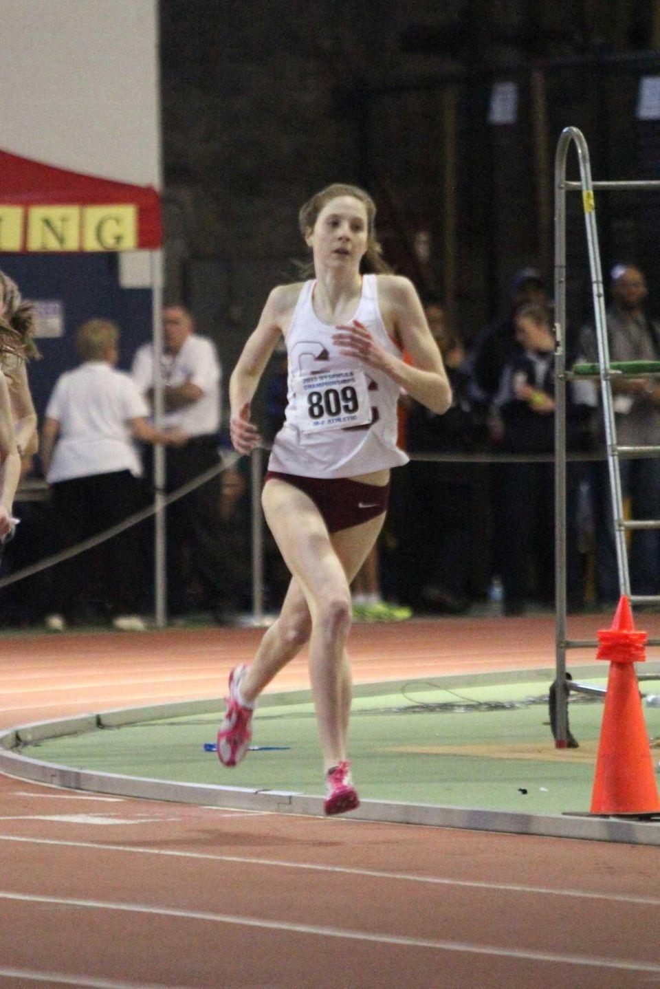 Garden City's Emma Gallagher runs in the 600