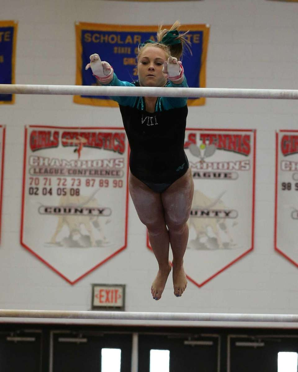 Wantagh's Brianna Quinn performs on the Uneven Bars