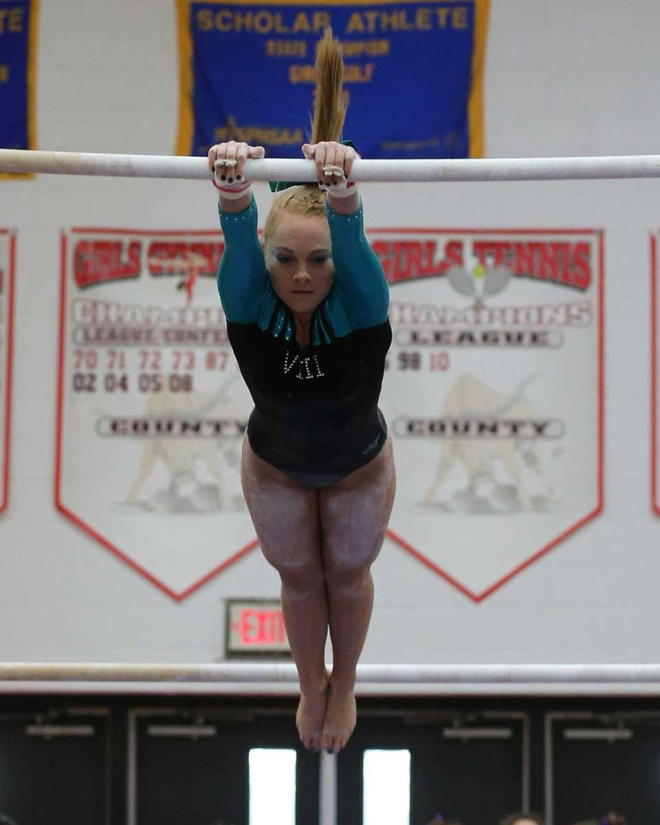 Wantagh's Brianna Quinn competes in the Uneven Bars