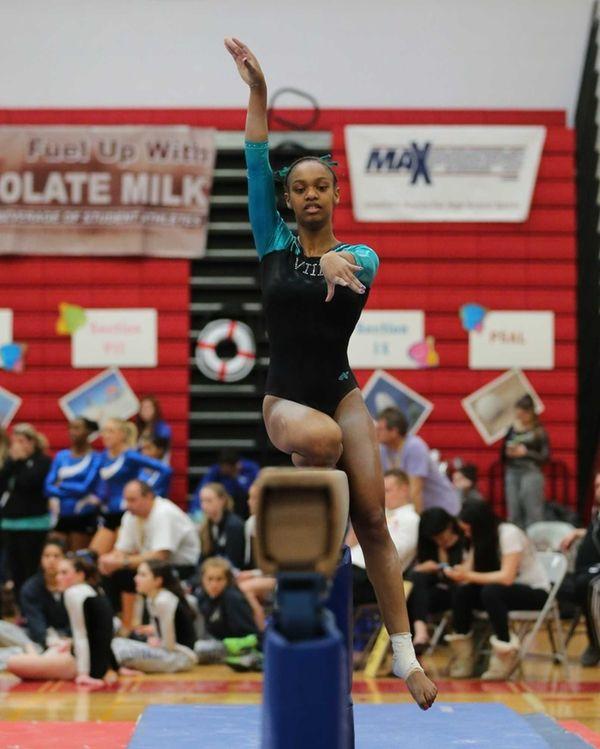 Sewanhaka gymnast Stephanie Jennings performs on the balance