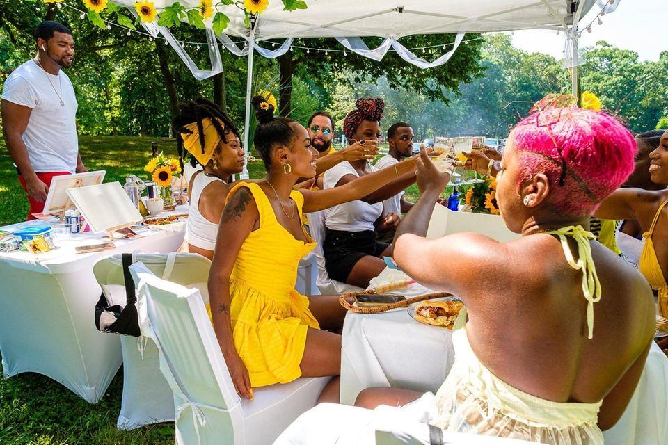Friends gather under a canopy to celebrate Mellissa