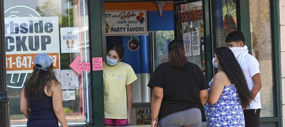 Customers and an employee of Ralph's Italian Ices