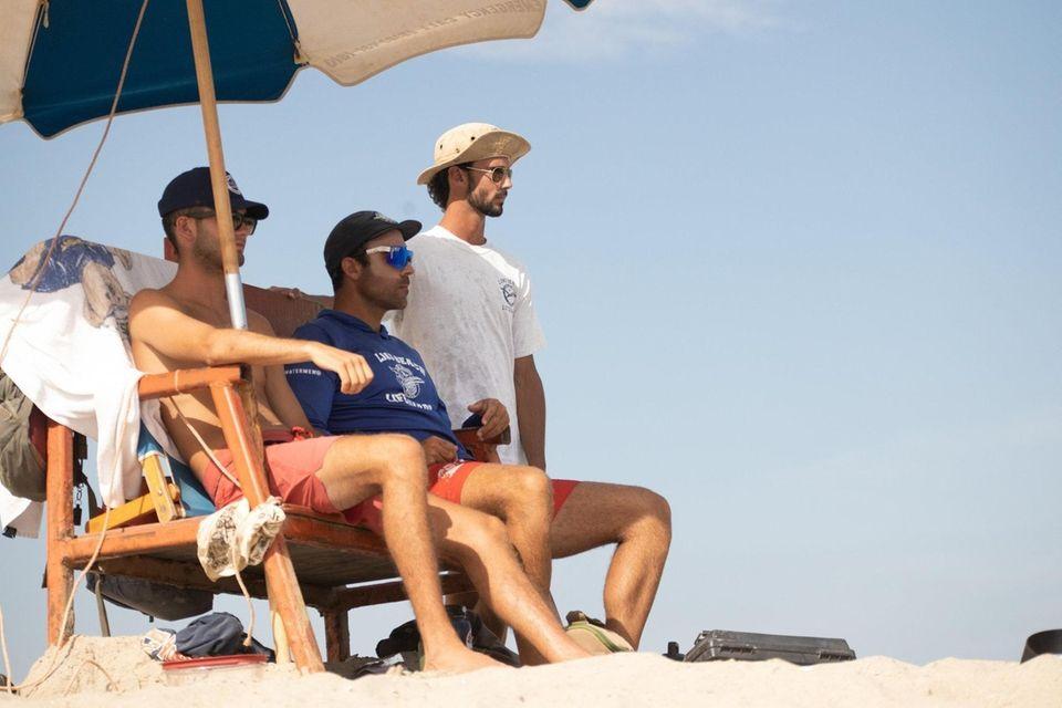 Long Beach lifeguards (left to right) Brendan Stark,