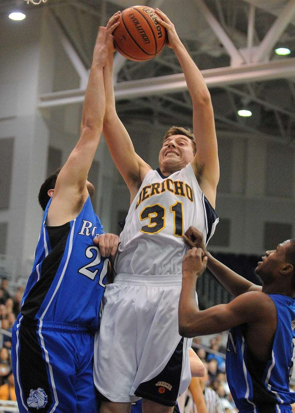 Jericho senior Erik Kanzer grabs a rebound during