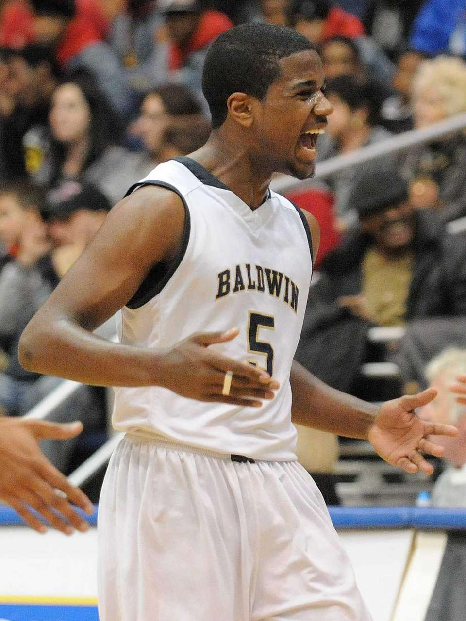 Baldwin's Elijah McMillan reacts after a Uniondale timeout