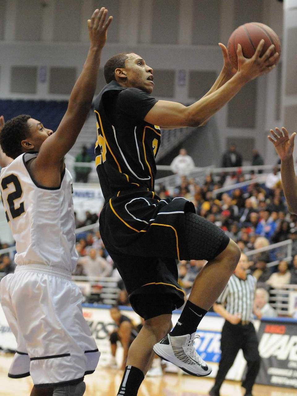 Uniondale's Aaron Cust, right, drive past Baldwin's Michael