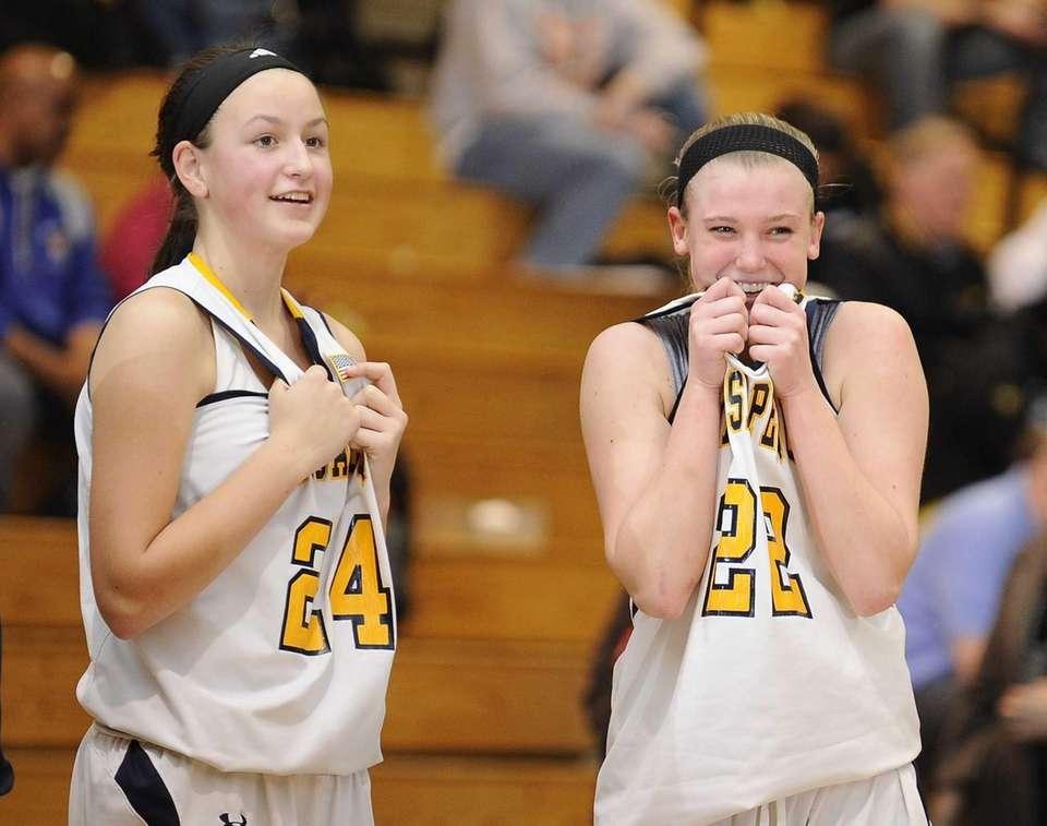 Massapequa's Melanie Hingher, left, and Lauren VanBuren, right,