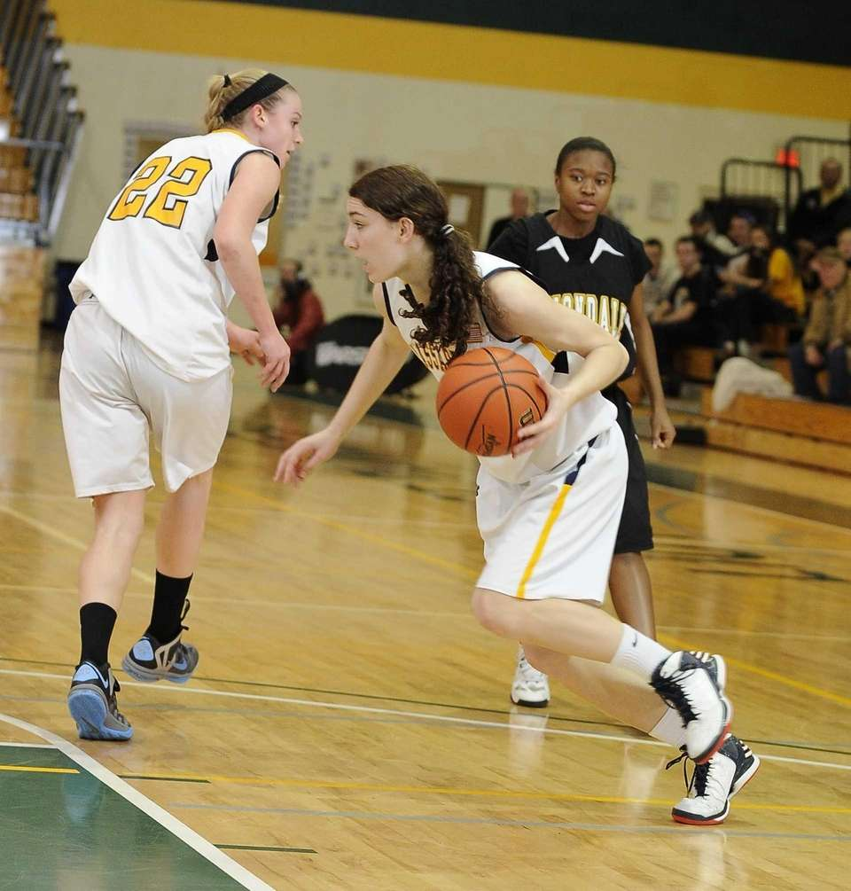 Massapequa's Morgan Roessler blocks a shot and drives