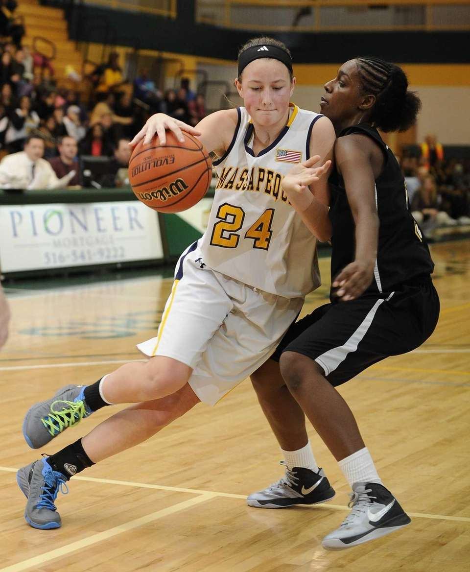 Massapequa's Melanie Hingher drives around Uniondale's Alicia Lebby