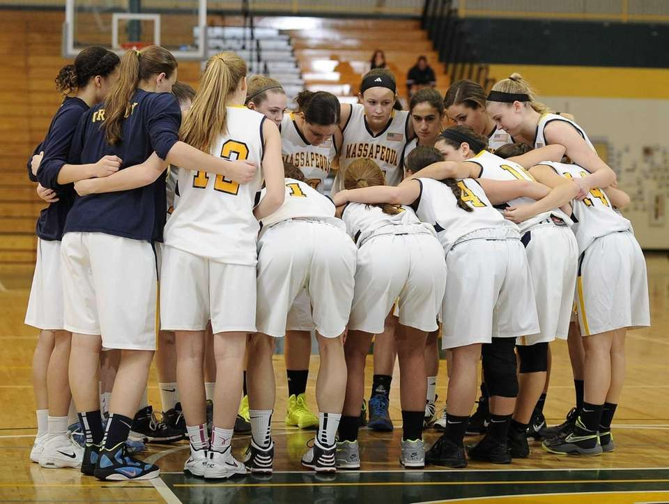 Massapequa players huddle before the game against Uniondale