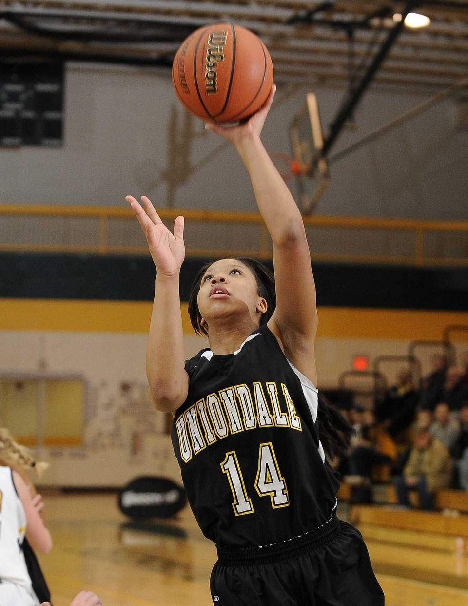 Uniondale's Jayda Hyatt scores against Massapequa in the