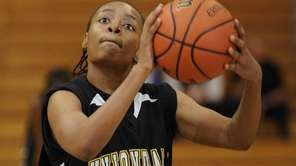 Uniondale's Aliyah McDonald shoots against Massapequa in the
