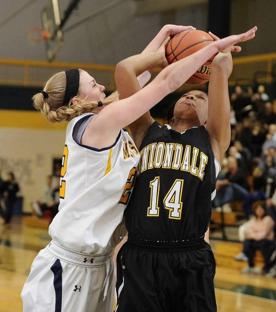 Uniondale's Jayda Hyatt is fouled by Massapequa's Lauren