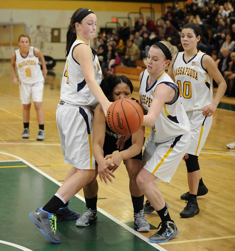 Uniondale's Jayda Hyatt loses possession under pressure from