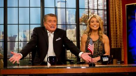 Regis Philbin and co-host Kelly Ripa appear on