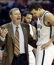 Brooklyn Nets head coach P.J. Carlesimo, left, talks