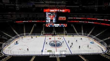 Edmonton Oilers players take to the ice for