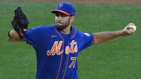 Mets pitcher David Peterson delivers a pitch during