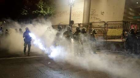 Federal officers deploy tear gas as they try