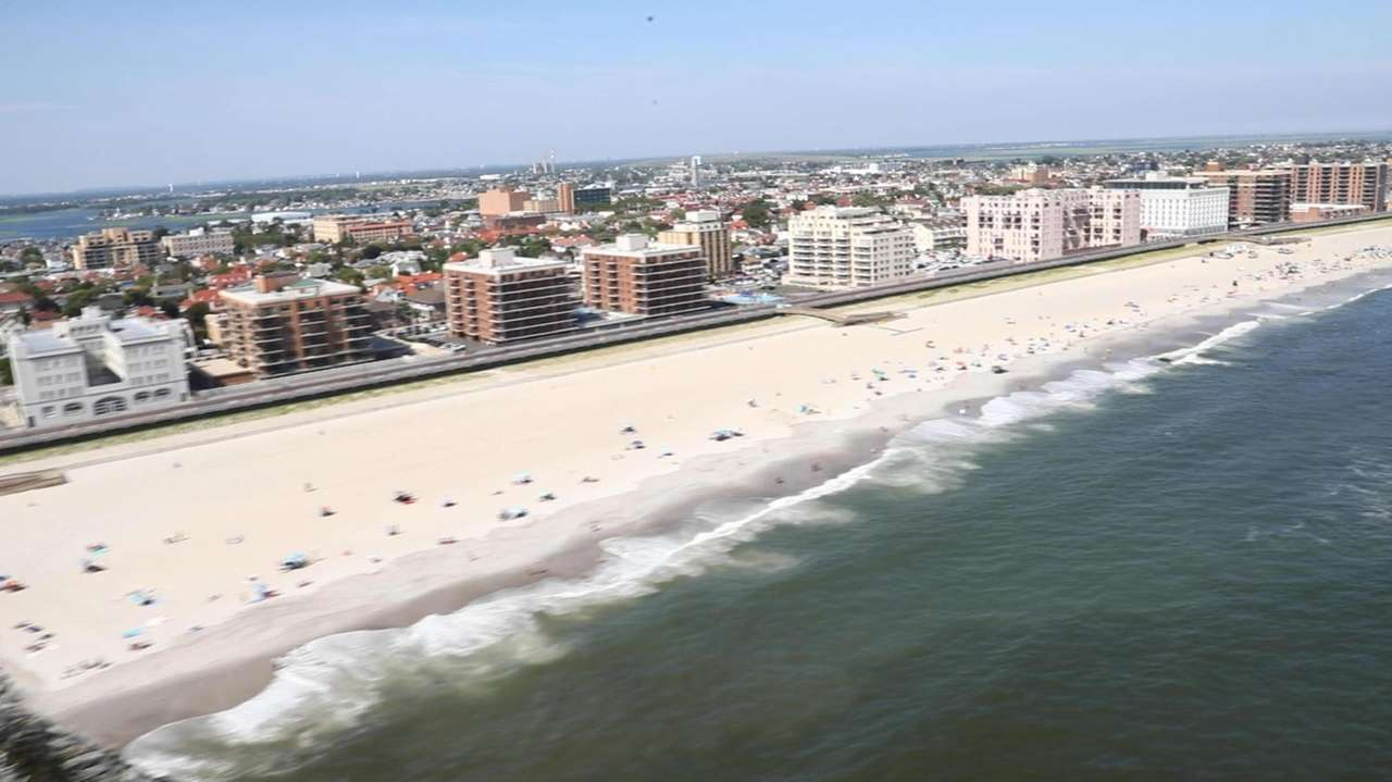 Officials reported shark sightings at several beaches Monday,