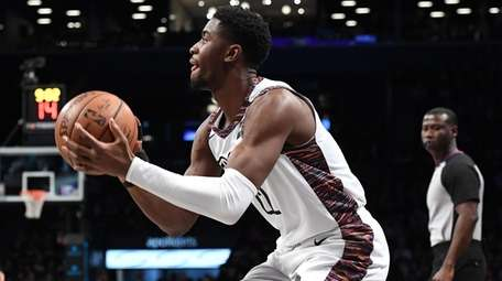 Nets guard Caris LeVert sets before shooting for