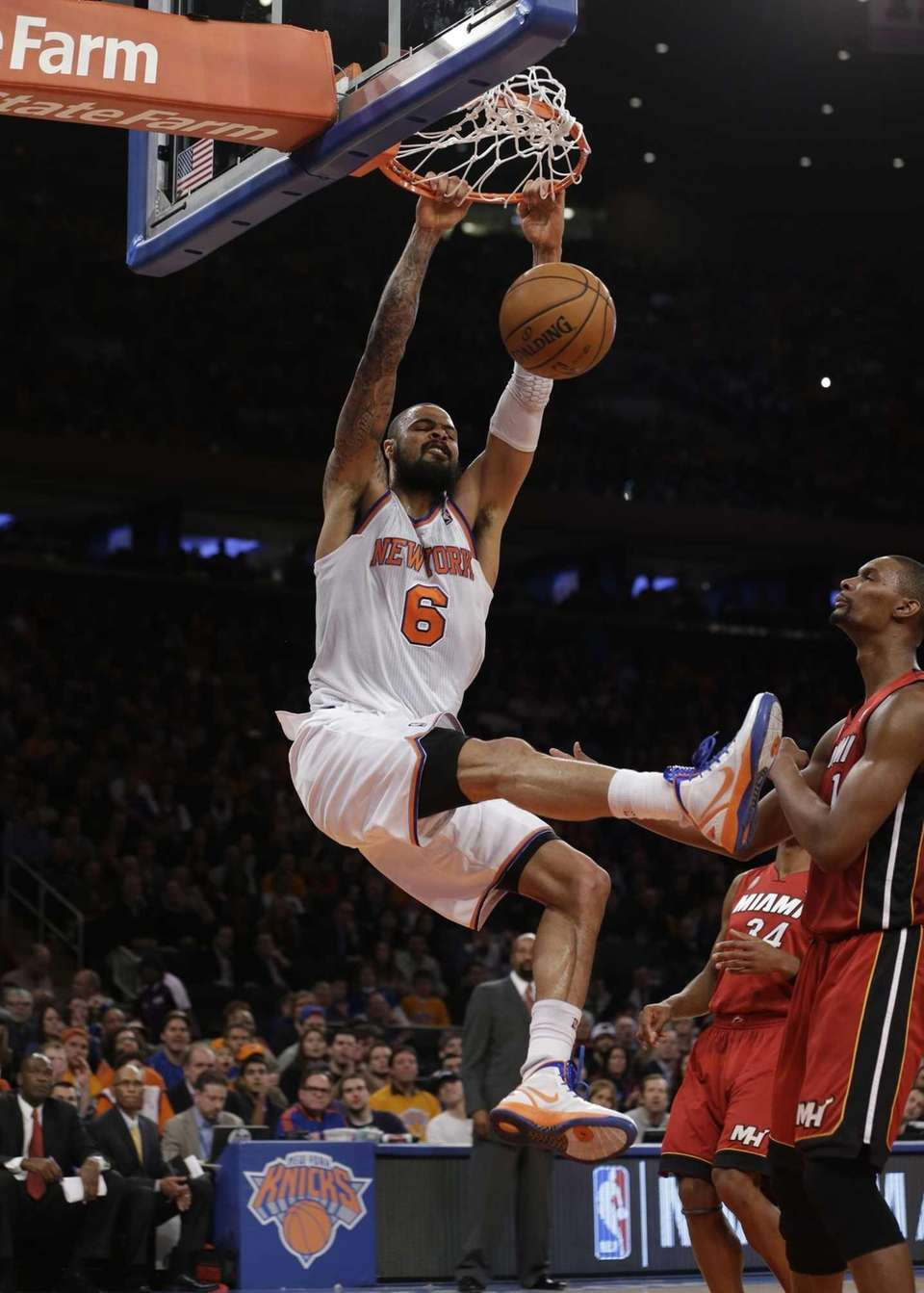 Tyson Chandler dunks in front of Miami Heat