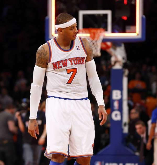 Carmelo Anthony looks on after a loss against