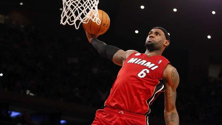 LeBron James dunks the ball in the second