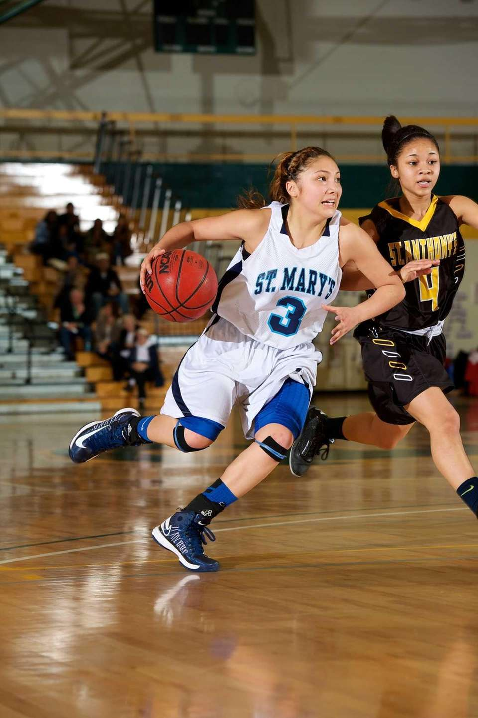 St. Mary's guard Mei-Lyn Bautista (3) drives the