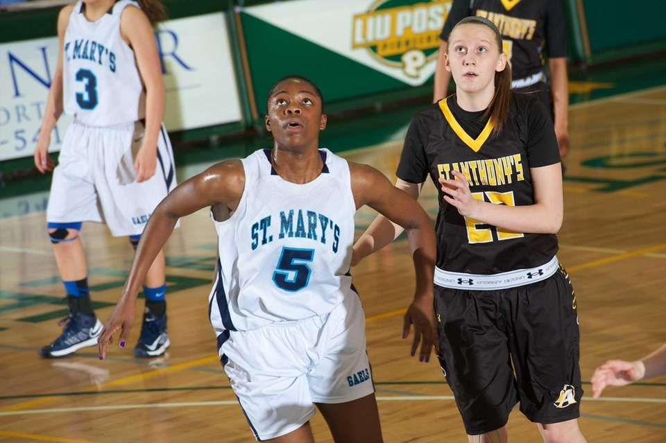 St. Anthony's forward Coutlet Bowlen (23) battles with