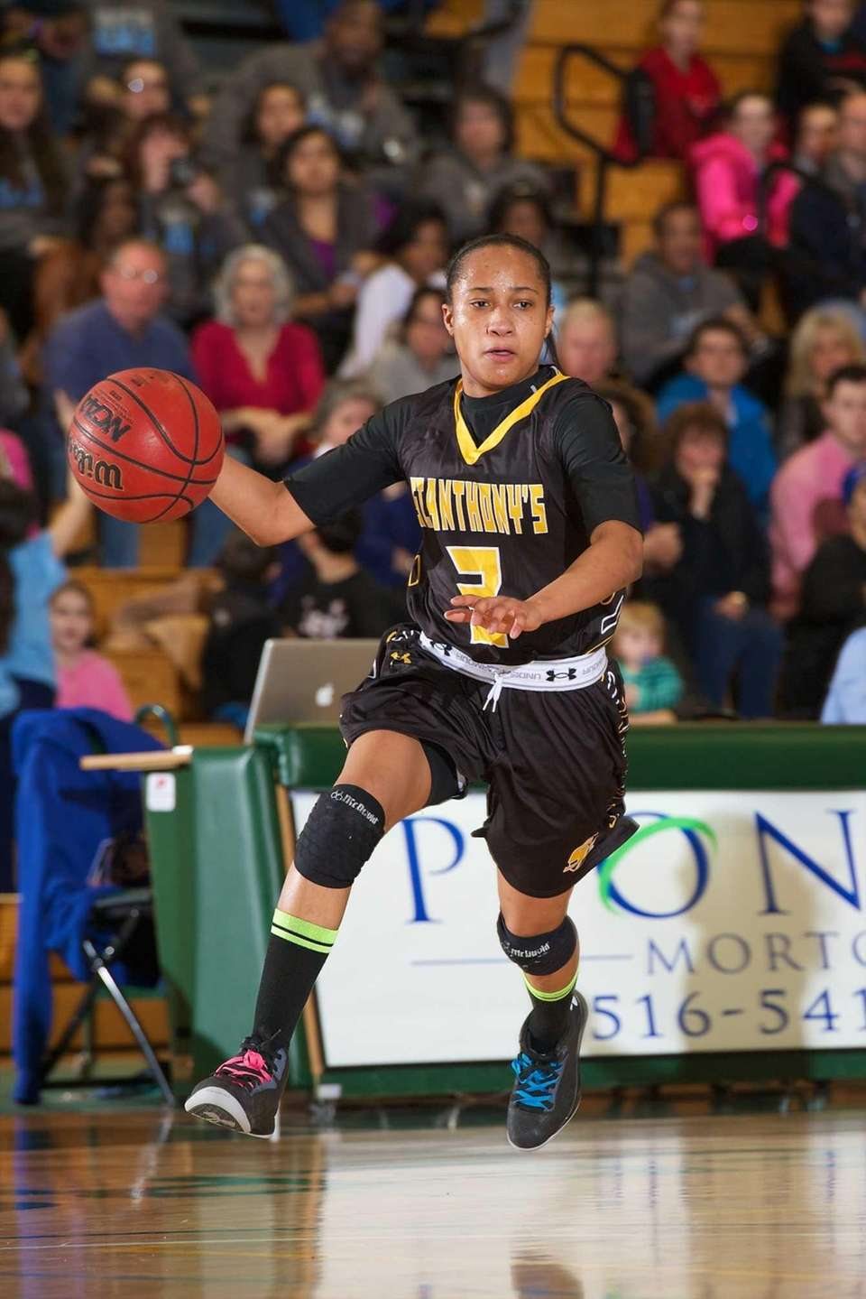 St. Anthony's guard Charise Wilson drives to the