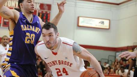 Stony Brook forward Tommy Brenton drives the baseline