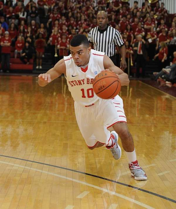 Stony Brook guard Carson Puriefoy drives the ball