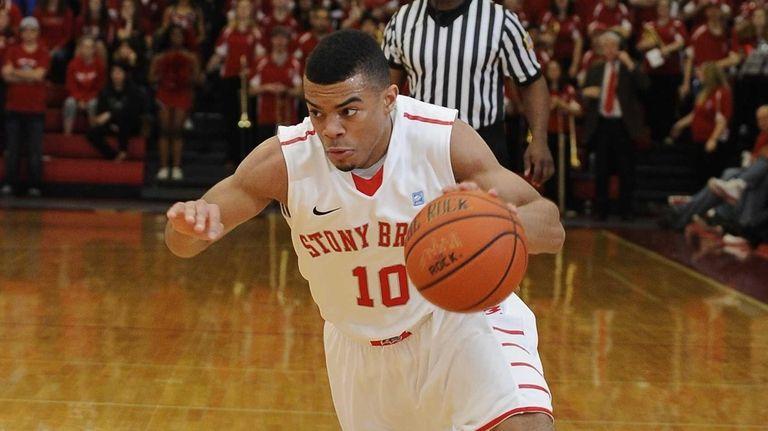 Stony Brook guard Carson Puriefoy drives the ball