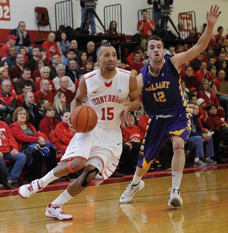 Stony Brook guard Leonard Hayes drives the ball