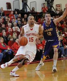 Stony Brook guard Leonard Hayes drives the ball