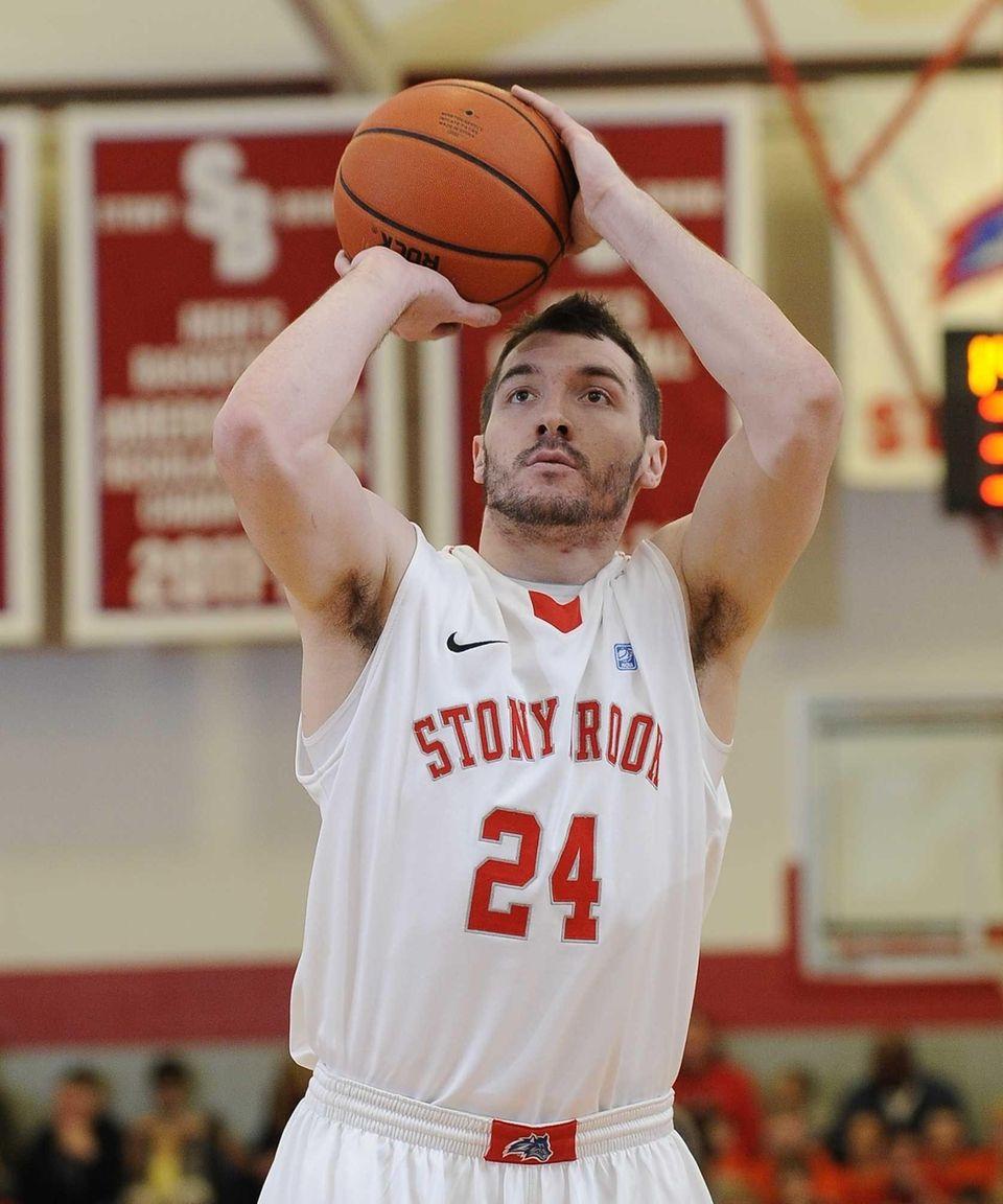 Stony Brook forward Tommy Brenton shoots a free