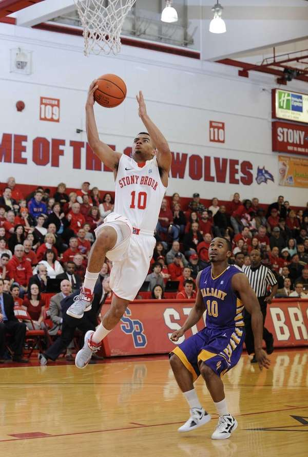 Stony Brook guard Carson Puriefoy scores on a