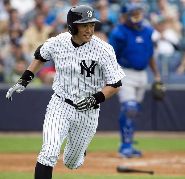 Ichiro Suzuki heads to first base after hitting