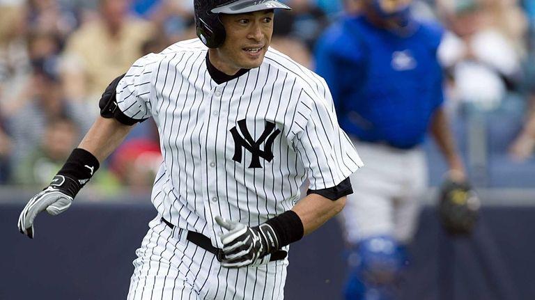 Ichiro Suzuki heads to first base after hitting