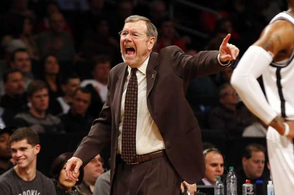 P.J. Carlesimo yells at his team during a