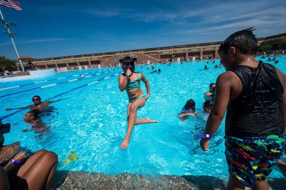 Mercy Alfaro, 8, of Queens stays cool Monday