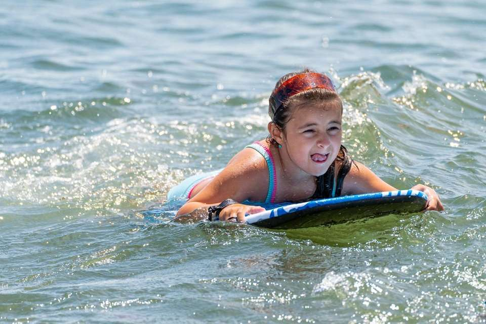 Demi Aggelatos, 7, from Mineola keep cool in