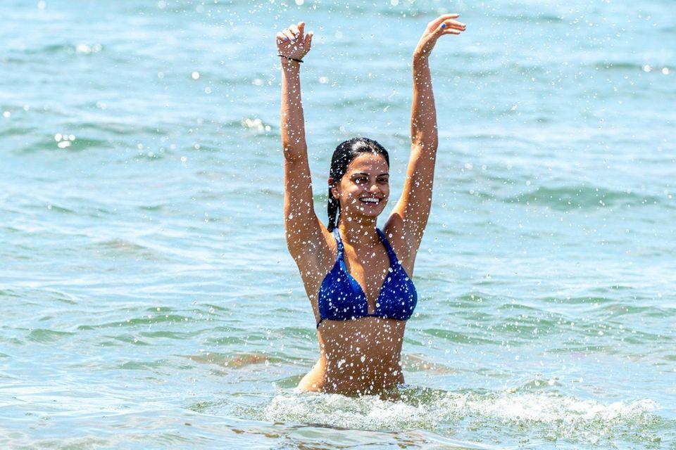 Amanda Ruszczycki, 23, from the Bronx splashes around