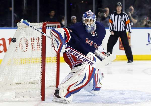 Henrik Lundqvist defends the net in the first