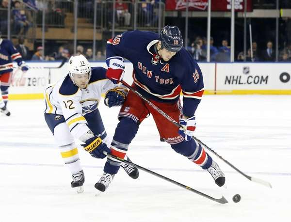 Marc Staal attempts a shot in the second