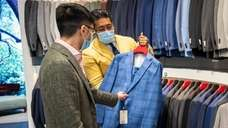 Westbury resident Dylan Su shops during a private