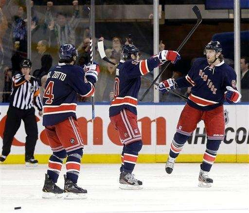 Rick Nash, right, celebrates his goal with teammates